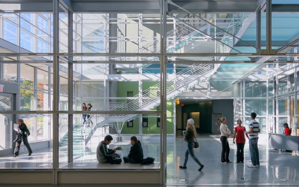 interior of glass building with students
