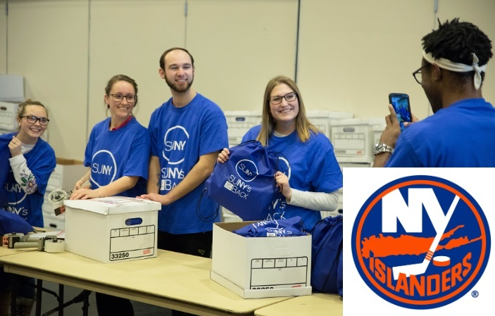 Students wearing blue SUNY t-shirts put together kits for SUNY's Got Your Back program.